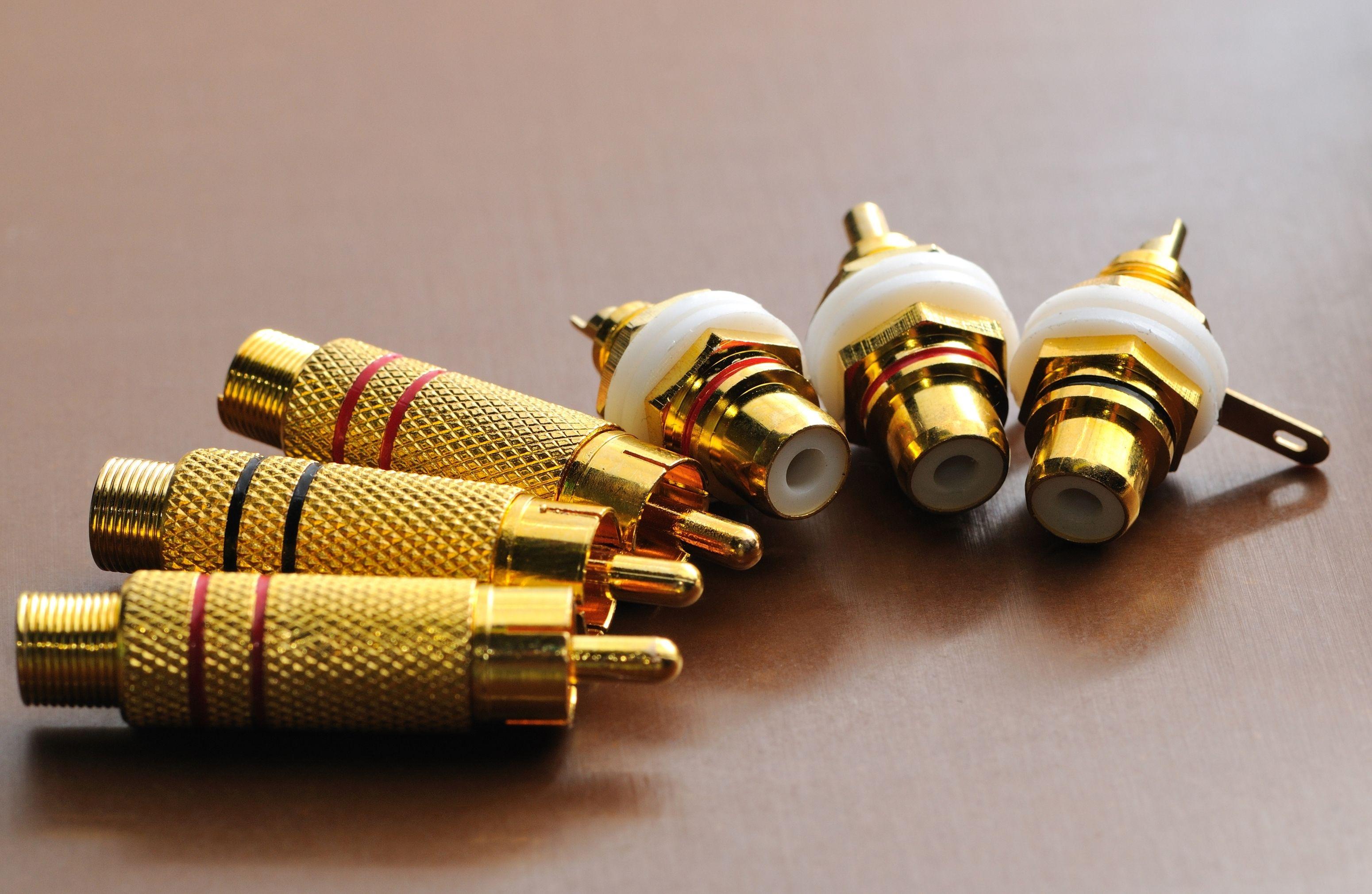 close-up-four-golden-plugs-stand-and-lie-VTXJZ7X.jpg